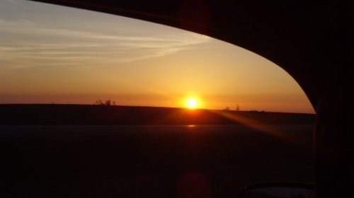 The sun starts to rise as we drive through middle America